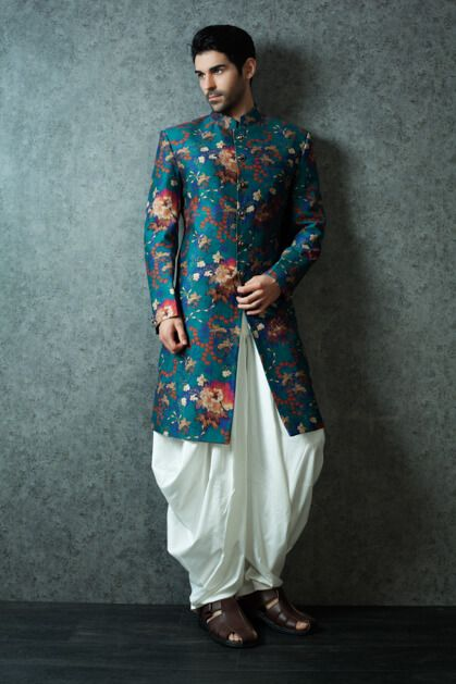 Wear the fashionable dhoti and kurta and make your mark as for Indo western wedding dress for men